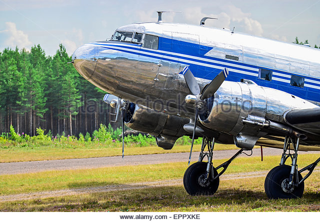 Old museum airplane Douglas DC-3 Dakota on grass airfield - Stock Image