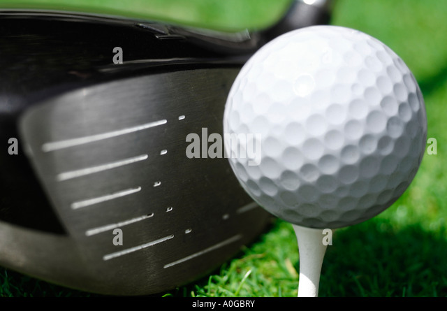 Close up of wood and golf ball on tee - Stock Image