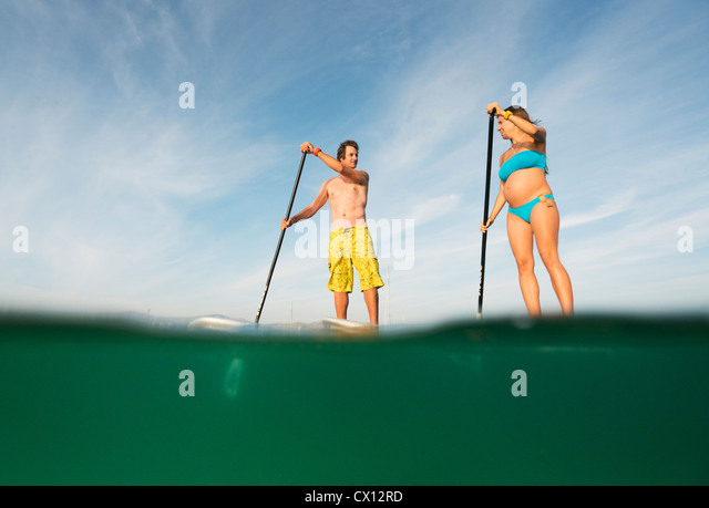 Stand up paddle surfing. - Stock Image
