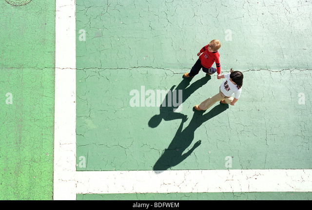 Hi angle of brother and sister walking - Stock Image