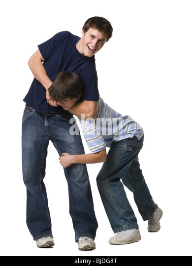 two brothers wrestling. - Stock Image