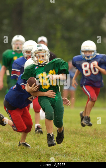 Youth American football game action  - Stock Image