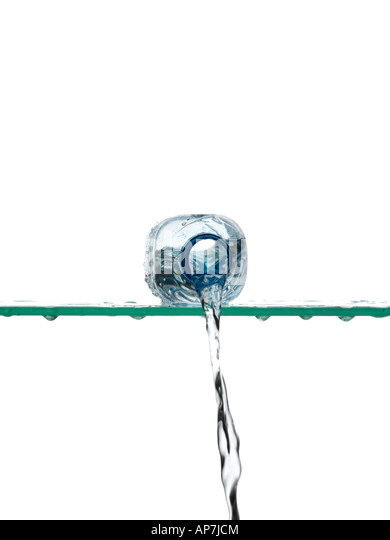Water pouring from bottle - Stock Image