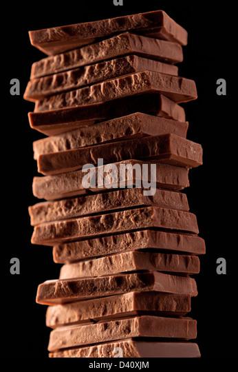 Milk chocolate pieces - Stock Image