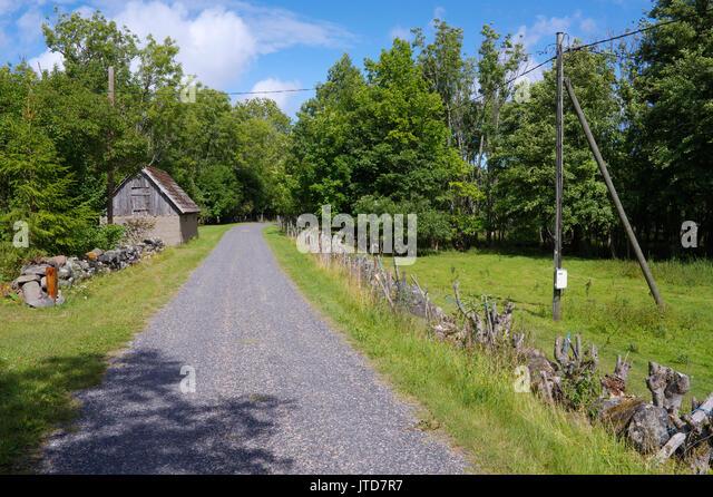 Kihnu village road. Island Kihnu, Estonia, Baltic States, 5th August 2017 - Stock Image