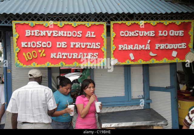 Panama City Panama Ancon Mercado de Mariscos market selling kiosk fruit juice drink sign Hispanic man woman Spanish - Stock Image