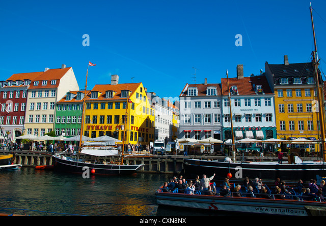 Sightseeing cruise tour boat Nyhavn harbour central Copenhagen Denmark Europe - Stock Image