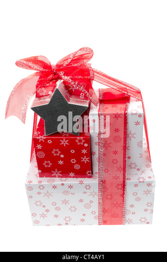 Gift wrapped boxes tied with a red ribbon in a bow - studio shot with a white background. - Stock Image