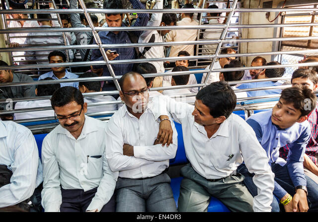 India Mumbai Asian Andheri Railway Station Western Line public transportation train commuters riders passengers - Stock Image