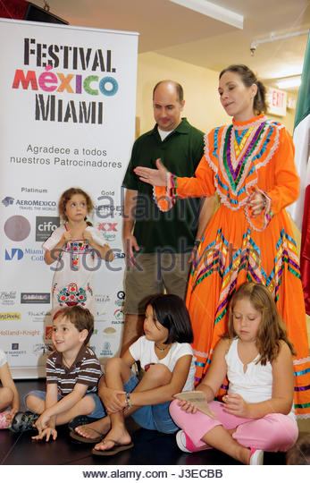 Miami Florida Miami Art Central Festival Mexico Miami Jalisco dress outfit Hispanic woman man girls boy children - Stock Image