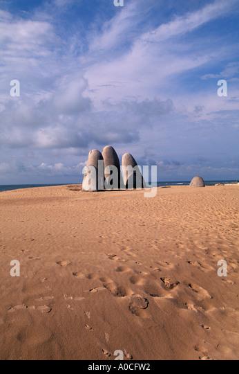 Uruguay Punte del Este Finger Beach Sculpture Dedos portrait of a person drowning - Stock Image