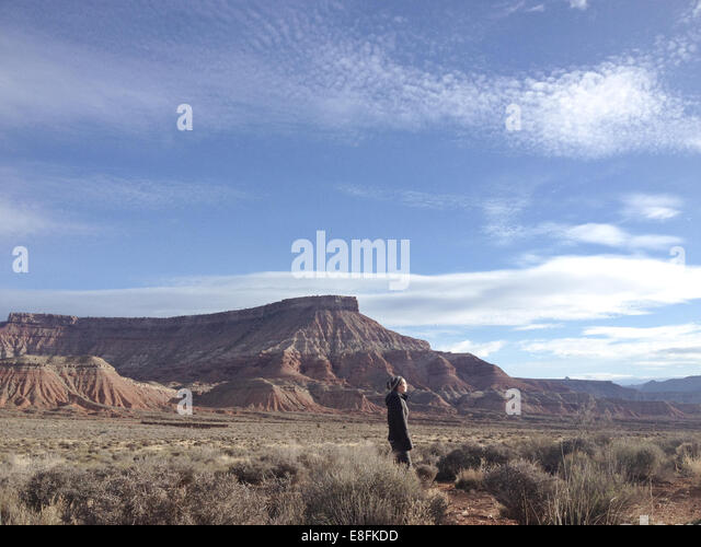 USA, Utah, Woman enjoying landscape near Zion National Park - Stock Image