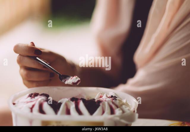 Woman eating ice cream - Stock Image