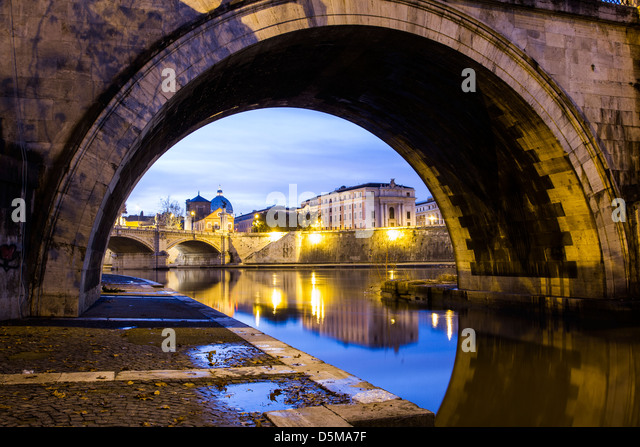 Arch of Sant'Angelo Bridge and Vittorio Emanuele II Bridge (Ponte Vittorio Emanuele II) in the background at - Stock Image