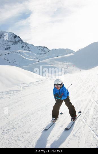 Boy skiing downhill, Les Arcs, Haute-Savoie, France - Stock Image