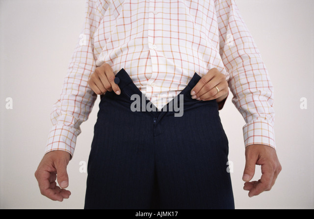 Woman undoing man's trousers - Stock Image