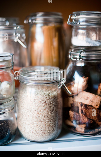 Glass jars with different content - Stock Image