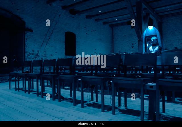 Man in an empty tumbledown cinema hall - Stock-Bilder