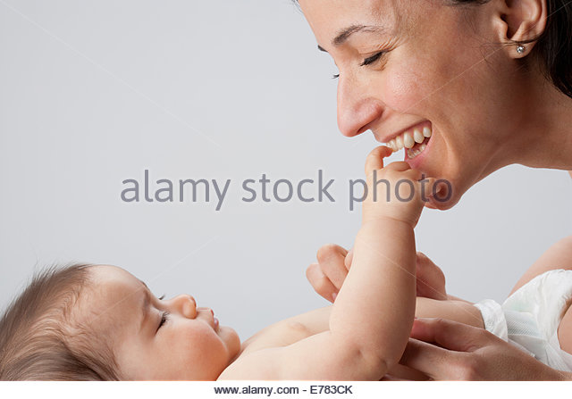 A woman playing with baby - Stock-Bilder