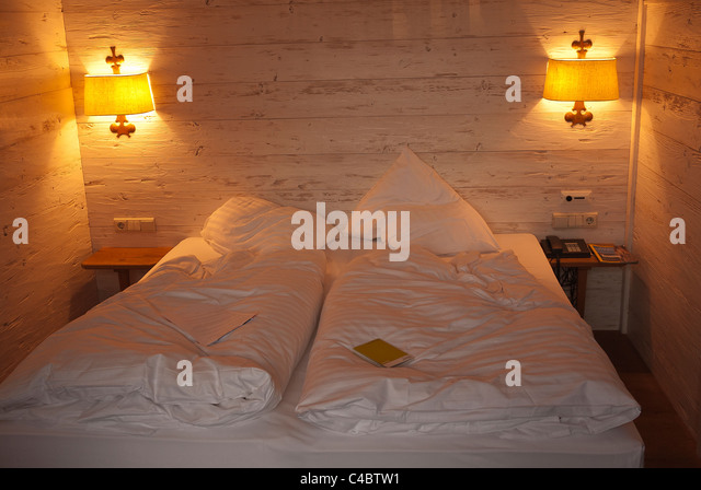 Double bed in a traveler's Hotel Bedroom, Munich Germany. - Stock Image