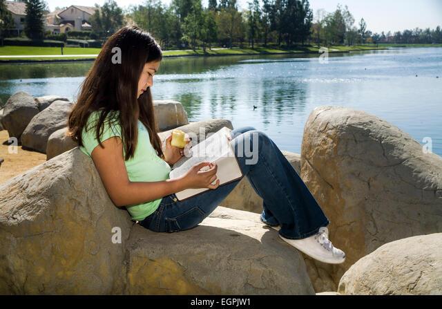 Hispanic Caucasian girl reading  Bible multi ethnic inter racial diversity racially diverse multicultural cultural - Stock-Bilder