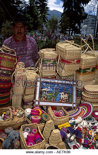 Ecuador Quito Alameda Parc park Sunday Open Market Cotopaxi male sells arts and crafts - Stock Image