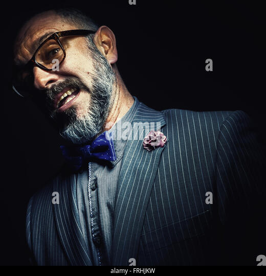 Portrait of a middle aged beard man, facial expression details. - Stock Image