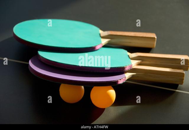 Ping Pong paddles table and balls - Stock Image