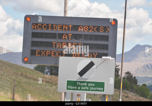 A82 LED traffic sign warning motorists of delays ahead because of an accident at Tarbet, Scotland, UK - Stock Image