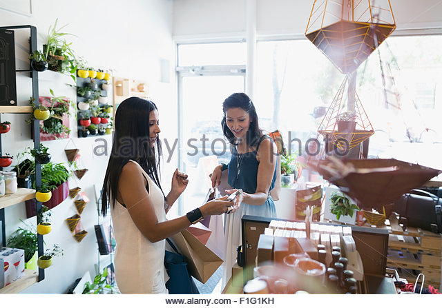 Women shopping in housewares shop - Stock Image