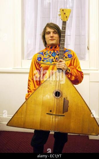 Contrabass balalaika. The balalaika  is a Russian folk stringed musical instrument with a characteristic triangular - Stock Image