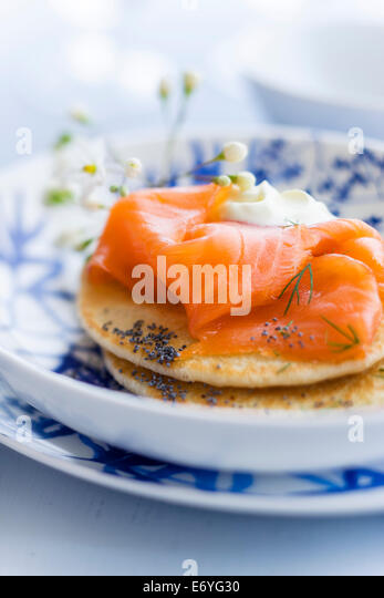 Blinis with salmon - Stock Image