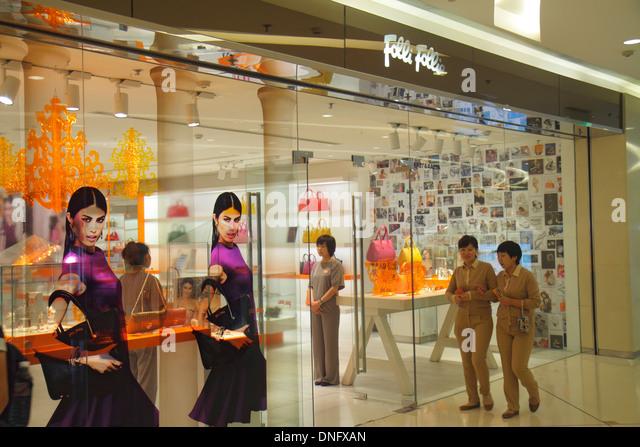 Beijing China The Malls at Oriental Plaza shopping store entrance front Folli Follie Asian woman women's handbags - Stock Image