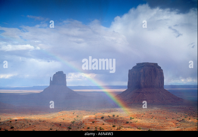 a rainbow over Monument Valley Utah USA - Stock-Bilder