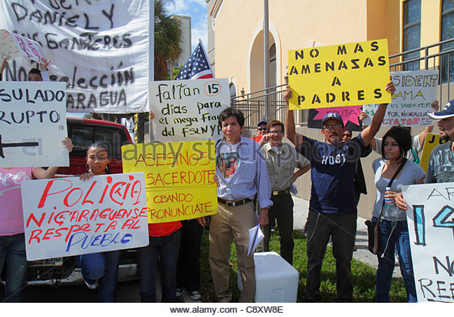 Miami Florida Flagler Street near Consulate General of Nicaragua protest protesters signs demonstration Spanish - Stock Image