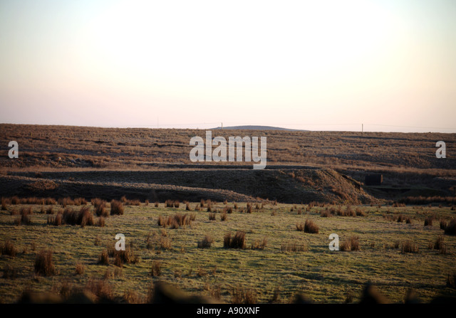 View across the Cheesden Valley towards the raised lodge of which fed Cheesden Pasture Mill near Heywood Lancashire - Stock Image