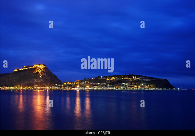Panoramic night view of Nafplio town with the castles of Palamidi and Akronafplia right above it. Argolis, Peloponnese, - Stock Image