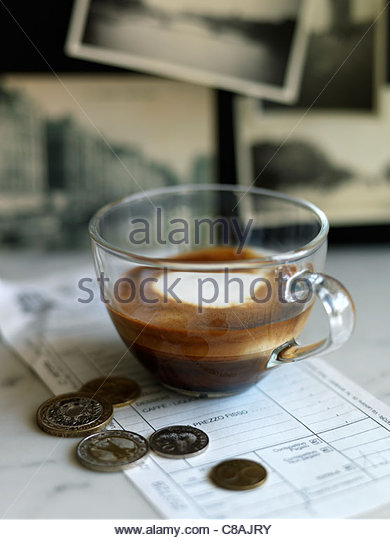 Cup of expresso with the bill and change - Stock Image