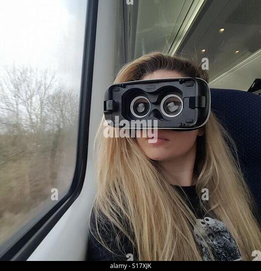 VR Girl on train - Stock Image