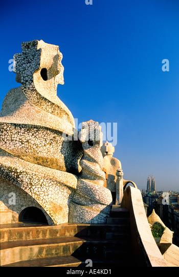 ESP Spain Barcelona Casa Mila by Antoni Gaudi Passeig de Gracia chimney background Sagrada Familia - Stock Image