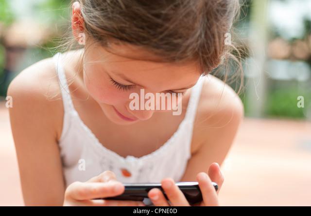 Girl playing video game - Stock-Bilder