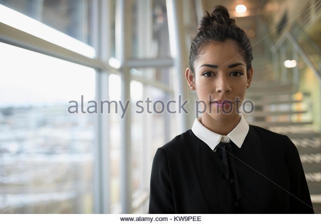 Portrait confident,determined Latina businesswoman - Stock Image