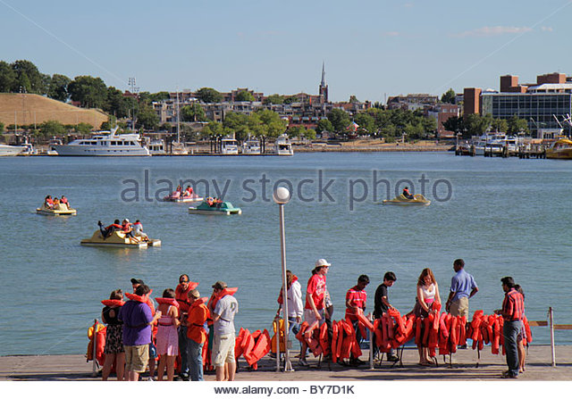 Baltimore Maryland Inner Harbor Patapsco River port waterfront Harborplace attraction paddle boat ride queue line - Stock Image