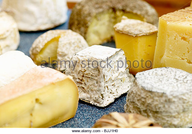 Various types of cheese on a board - Stock Image