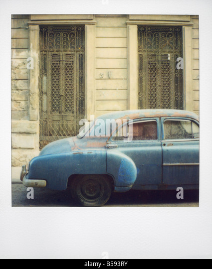 Polaroid of old blue American car covered in dust Havana Cuba West Indies Central America - Stock Image