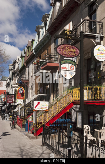Row of cafeterias, bars, restaurants and shops on Rue Saint-Denis, Saint Denis Street, Latin Quarter, Montreal, - Stock Image