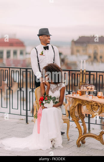 Happy african newlyweds smiling on the terrace - Stock Image