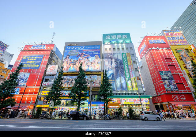 Billboards in Akihabara known as Electric Town or Geek Town selling Manga based games and videos in Tokyo Japan - Stock Image