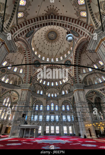 Istanbul, Turkey - April 25, 2017: Interior of Fatih Mosque, a public Ottoman mosque in Fatih district with a huge - Stock Image