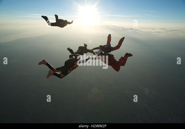 A skydiver closing in on a formation in freefall - Stock Image